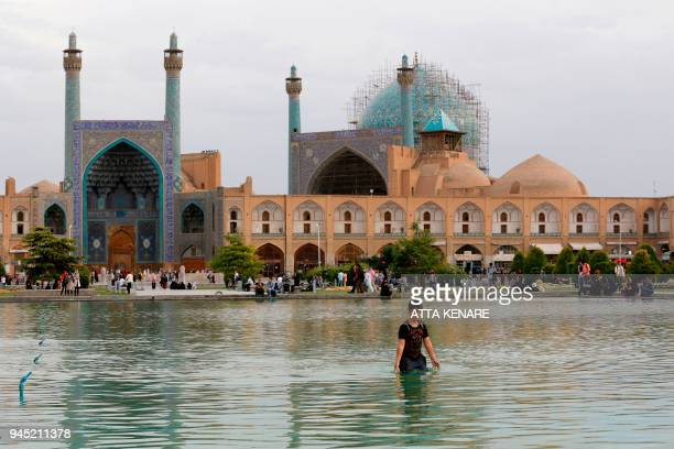 People visit the historical Naqshe Jahan Square in Isfahan on April 12 2018 / AFP PHOTO / ATTA KENARE