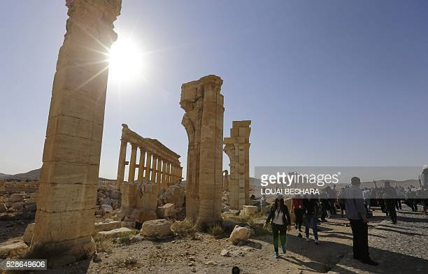 People visit the historical site of the ancient theatre of Syria's ravaged Palmyra on May 6, 2016 ahead of a music concert following its recapture by...