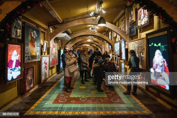 People visit the house of Santa Claus in the Reggia of Venaria on December 2 2017 in Turin Italy