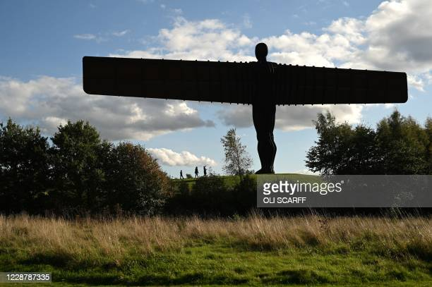People visit the iconic 'Angel of the North' sculpture, designed by Antony Gormley in Gateshead, northeast England in Gateshead, northeast England on...