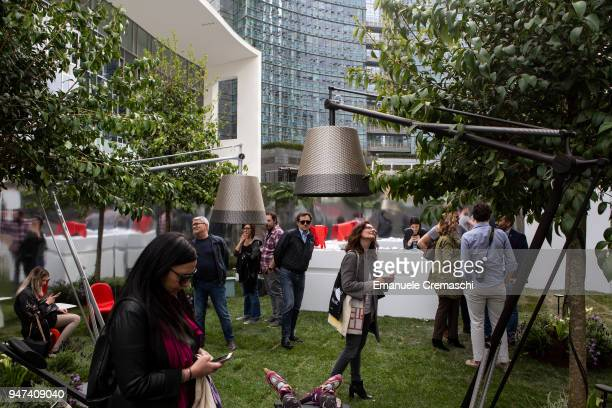 People visit the installation 'Hidden Garden' at Piazza Age Aulenti on April 16 2018 in Milan Italy Every year Salone and Fuorisalone define the...