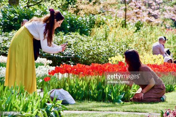 People visit the Keukenhof one of the world's largest flower and tulip garden in Lisse Netherlands on April 18 2019 This year's theme of the floral...