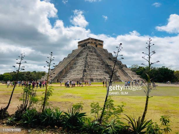TOPSHOT People visit the Kukulcan Pyramid at the Mayan archaeological site of Chichen Itza in Yucatan State Mexico on February 13 2019