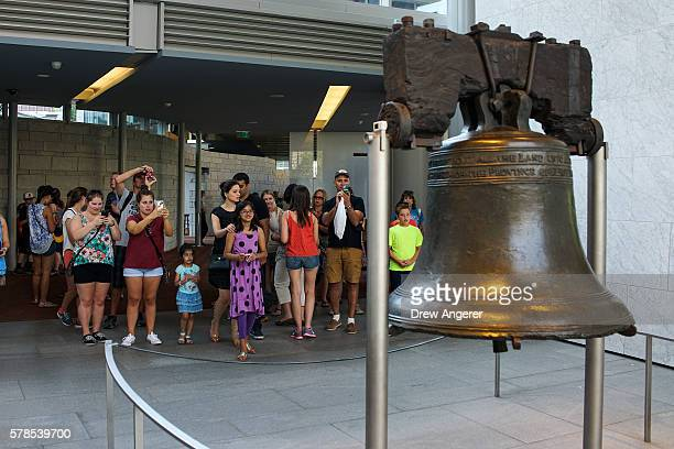 People visit the Liberty Bell July 21 2016 in Philadelphia Pennsylvania The Democratic National Convention will formally kick off in Philadelphia on...