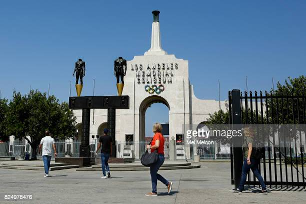 People visit the Los Angeles Memorial Coliseum in Los Angeles on July 31 2017 Los Angeles has reached an agreement with Olympic leaders on terms that...