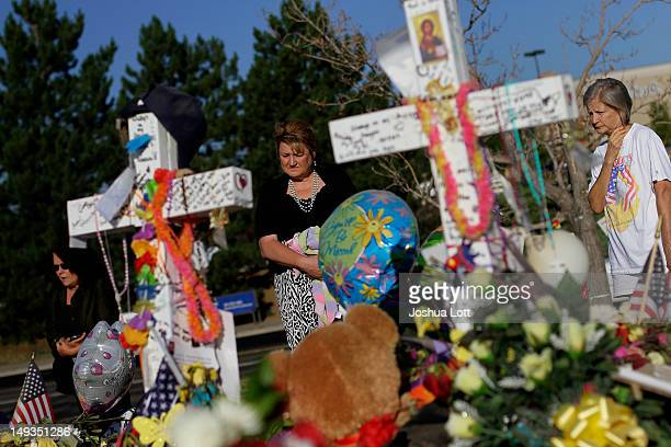 People visit the makeshift memorial for the 12 movie theater shooting victims built across the street from the Century 16 Theater July 27 2012 in...