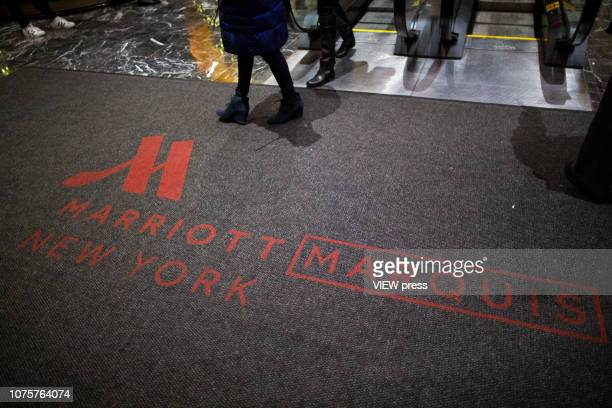 People visit the Marriott International hotel in Times Square on December 1 2018 in New York The largest hotel chain in the world The Marriott...