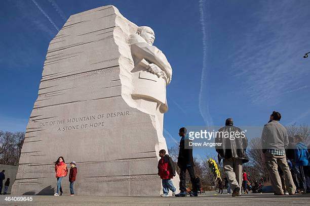 People visit the Martin Luther King Jr Memorial January 20 2014 in Washington DC Americans marked the birth and legacy of civil rights leader Martin...