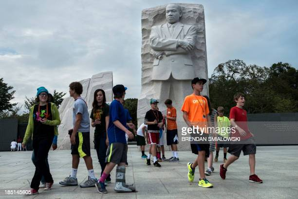 People visit the Martin Luther King Jr Memorial on the National Mall October 17 2013 in Washington DC The US federal government reopened after a...