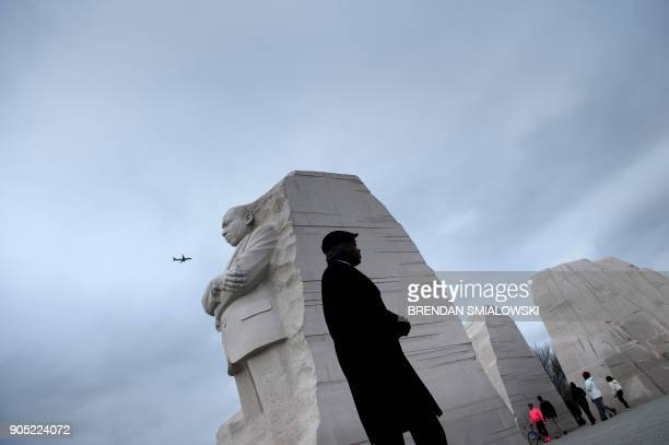 People visit the Martin Luther King Memorial on the National Mall January 15 2018 in Washington DC / AFP PHOTO / Brendan Smialowski