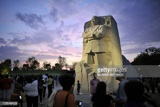 People visit the Martin Luther King sculpture on August 20011 in Washington DC The longawaited dedication of a US national memorial to slain civil...