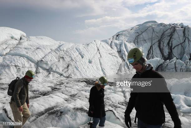People visit the Matanuska glacier on September 07 2019 near Palmer Alaska Some studies show that as global temperatures rise Alaska's 19000 glaciers...