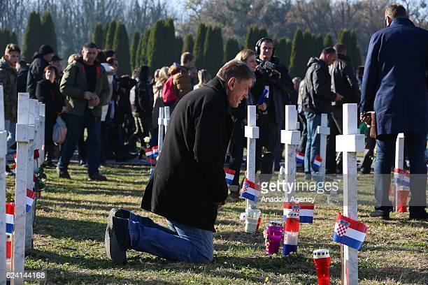 People visit the mausoleum during a commemoration ceremony on the 25th anniversary of the Vukovar massacre in Vukovar Croatia on November 18 2016 The...