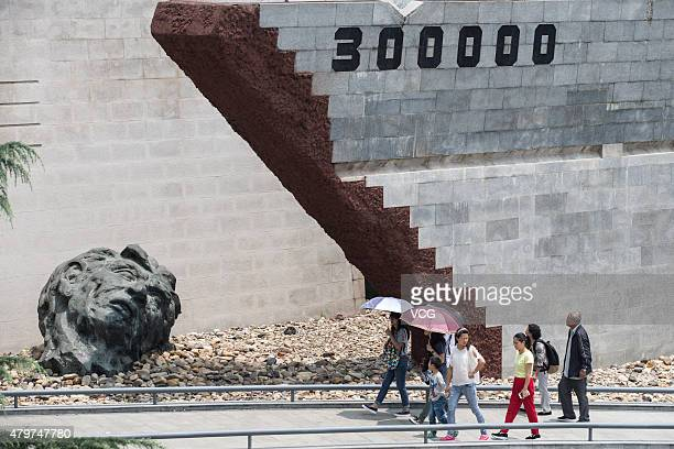 People visit the Memorial Hall of the Nanjing Massacre to mourn the victims killed by the Japanese on July 7 2015 in Nanjing Jiangsu Province of...