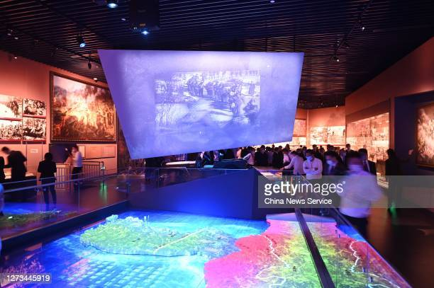 People visit the Memorial Hall of the War to Resist US Aggression and Aid Korea on the opening day on September 19, 2020 in Dandong, Liaoning...