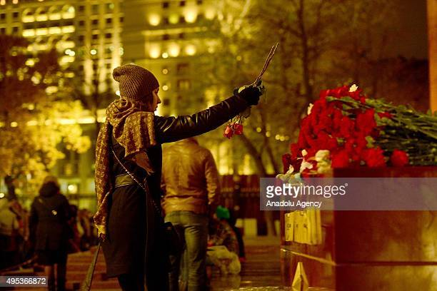 People visit the memorial stone at the Tomb of the Unknown Soldier outside Moscow's Kremlin Wall in Moscow Russia on November 2015 The A321 Russian...
