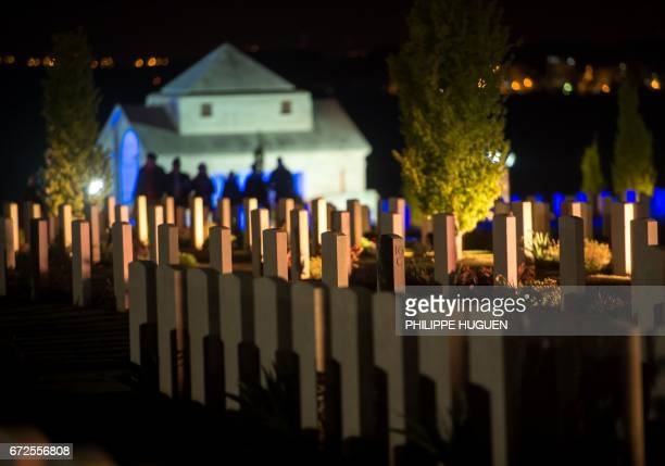 People visit the military cemetery of the Australian National Memorial in VillersBretonneux northern FRance on April 25 2017 during Anzac Day marking...