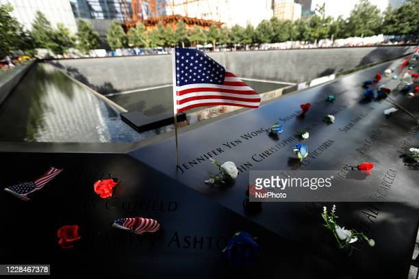 People visit the National September 11 Memorial and Museum prior to the night tribute on September 11, 2020 in New York City. The the evening tribute...