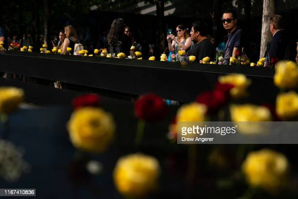 People visit the National September 11 Memorial on the 18th anniversary of the 9/11 attacks September 11 2019 in New York City Throughout the United...