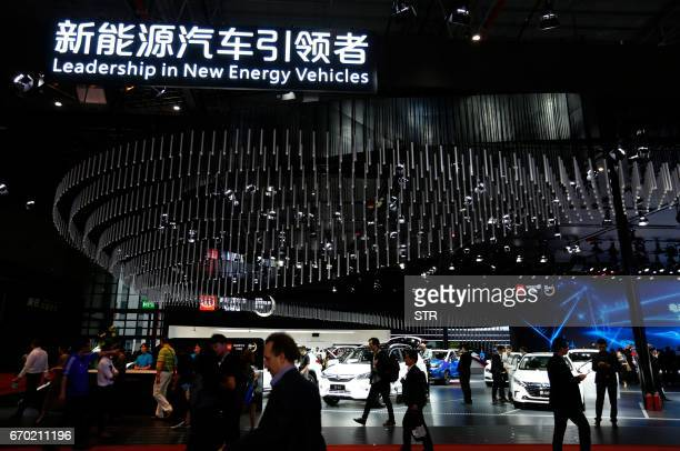 People visit the New Energy Vehicles area during the first day of the 17th Shanghai International Automobile Industry Exhibition in Shanghai on April...