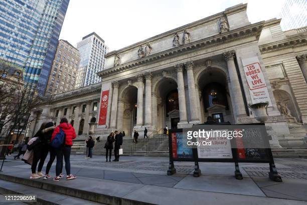 People visit the New York Public Library before it closes on March 13, 2020 in New York City. Due to the ongoing threat of the coronavirus outbreak...