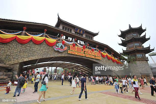 People visit the newly open theme park Wanda City in Nanchang east China's Jiangxi province on May 28 2016 The Chinese conglomerate Wanda on May 28...
