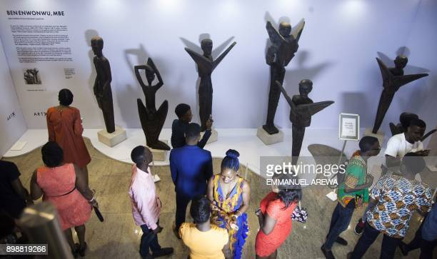 People visit the Nigeria annual Art X event in Lagos on November 4 2017 / AFP PHOTO / EMMANUEL AREWA