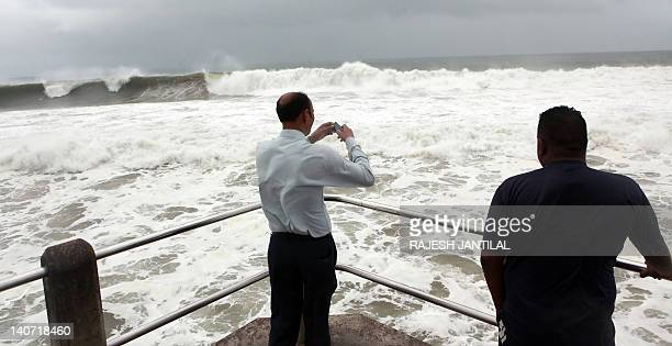 People visit the North Pier beach in Durban on March 5 2012 to view huge waves caused by tropical Cyclone Irina which brought heavy storms over parts...