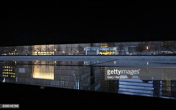 People visit the north pool at the National 9/11 Memorial outside One World Trade Center on January 12, 2017 in New York City.