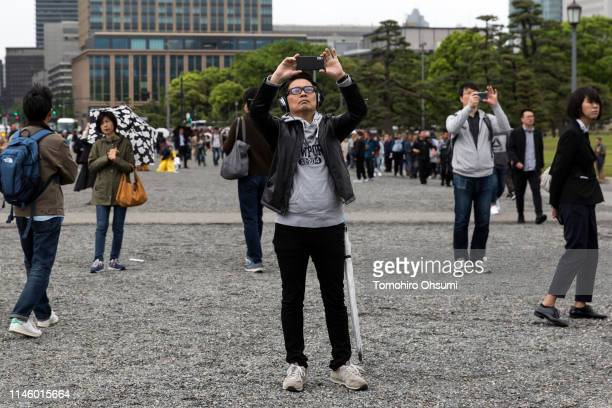 People visit the outer garden of the Imperial Palace on April 30 2019 in Tokyo Japan Japan's 85yearold Emperor Akihito became the first Japanese...