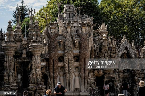 People visit the Palais Ideal created by late French postman Ferdinand Cheval better known as Facteur Cheval on September 11 2019 in Hauterives The...