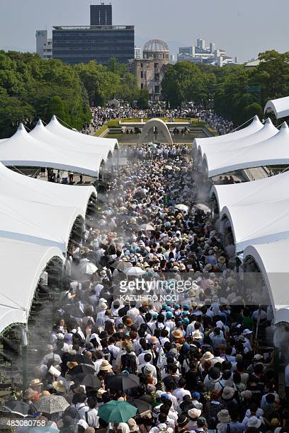 People visit the Peace Memorial Park to pray for victims of the atomic bombing in Hiroshima on August 6 2015 Tens of thousands gathered for peace...