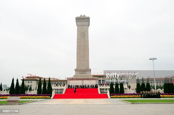 People visit the People's Heroes Monument during the commemoration ceremony for the first Martyrs' Day n Beijing's Tiananmen Square on September 30...