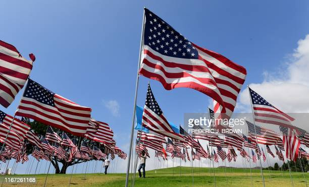 People visit the Pepperdine Wave of Flags display on September 10, 2019 at Pepperdine University in Malibu, California, commemorating those who died...