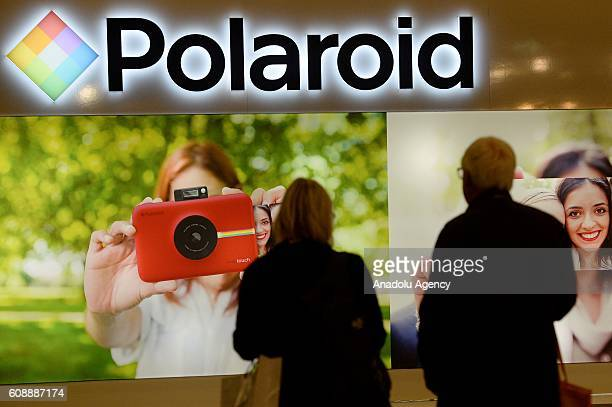 People visit the Photokina in Cologne, Germany, Tuesday, Sept. 20, 2016. More than 1000 exhibitors from 51 countries show the latest developments in...