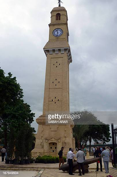 People visit the Qishleh Hour clock tower that was built during the era of the Ottoman occupation of Iraq on the banks of the river Tigris in Baghdad...