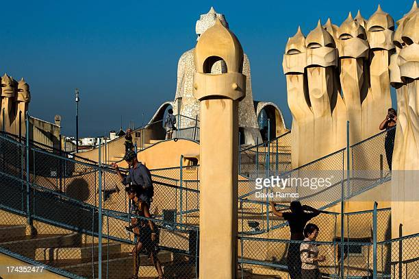 People visit the roof of Antoni Gaudi's building 'La Pedrera' or 'Casa Mila' on July 24 2013 in Barcelona Spain Foreign visitors to Spain set a new...