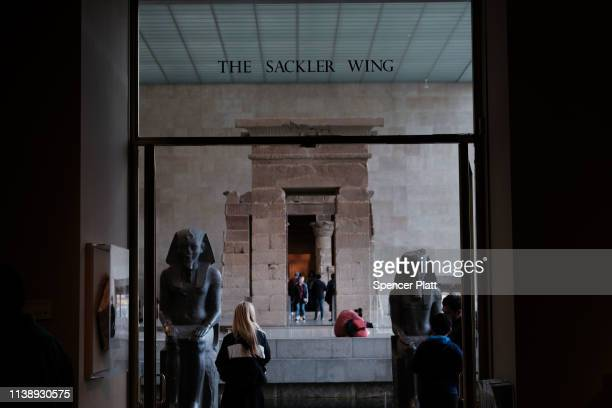 People visit the Sackler Wing at the Metropolitan Museum of Art on March 28 2019 in New York City Joining a growing list of state and local...