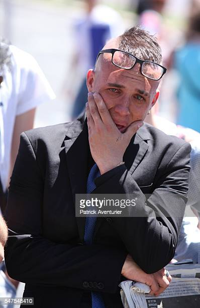 People visit the scene and lay tributes to the victims of a terror attack on the Promenade des Anglais on July 15 2016 in Nice France A...