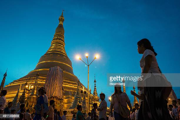 People visit the Shwedagon pagoda in Yangon Myanmar on Tuesday May 13 2014 Economic growth in Myanmar is expected to accelerate to 91 percent in...