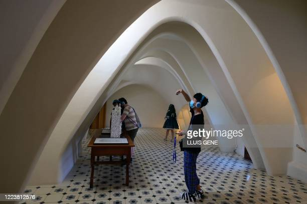 People visit the Spanish architect Antonio Gaudi's Casa Batllo on July 1, 2020 in Barcelona, on the first day it reopens to the public after more...