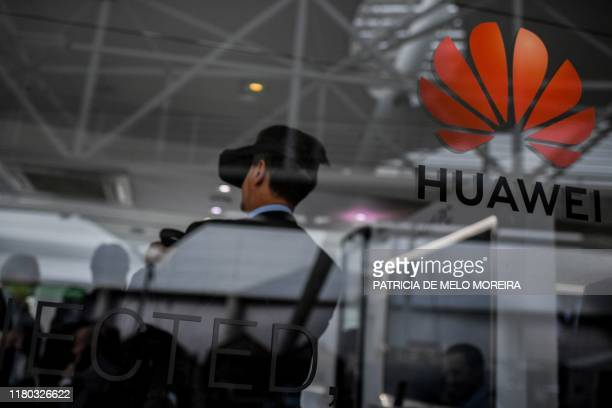People visit the stand of Chinese telecom giant Huawei during the Web Summit in Lisbon on November 6 2019 Europe's largest tech event Web Summit is...