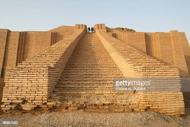 People visit the stepped Ziggurat temple a threetiered edifice dating back to 2113 BC in the ancient city of Ur in southern Iraq on February 4 2010...