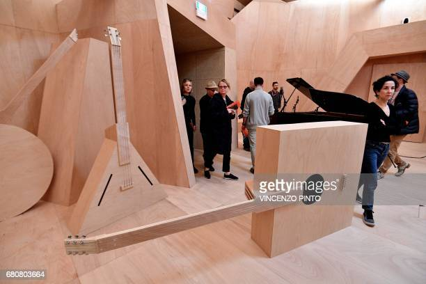"""People visit the """"Studio Venezia"""" a musical space made by French artist Xavier Veilhan during the press preview of the 57th International Art..."""