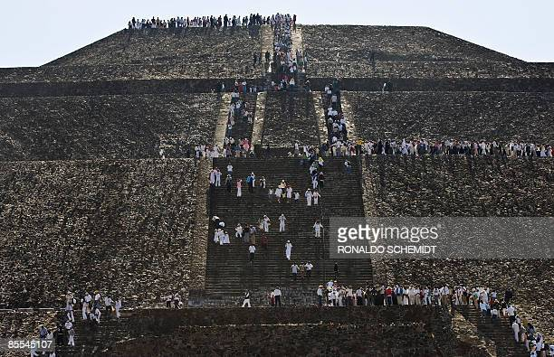 People visit the Sun Pyramid in Teotihuacan Mexico to take energy from the sun during the celebrations for the Spring Equinox on March 21 2009 Since...