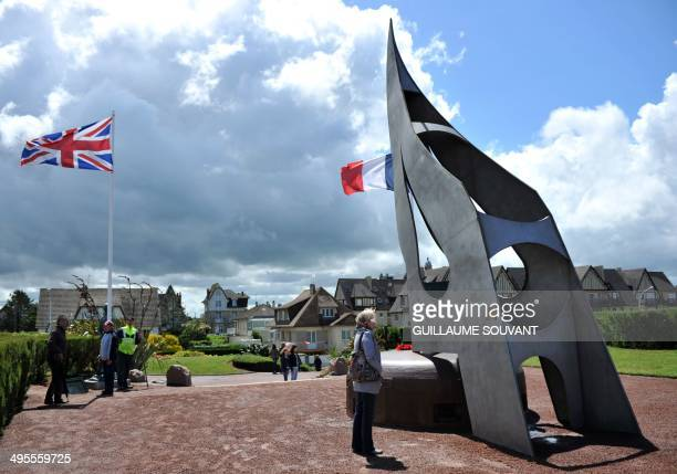 People visit the Sword Beach landing memorial in Ouistreham, northwestern France, on June 4 two days before the start of the D-Day commemorations....