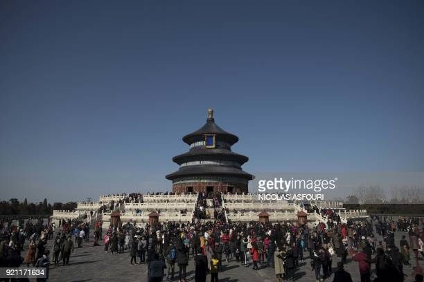 People visit the Temple of Heaven during the Lunar New Year holidays in Beijing on February 20, 2018. China is in the midst of a week-long holiday...
