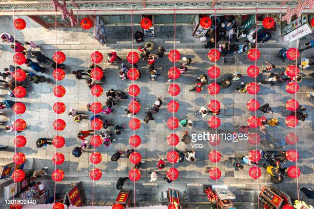 People visit the Tianjin's Ancient Culture Street, a pedestrian pathway complex, to celebrate Chinese New Year, the Year of the Ox, on February 12,...