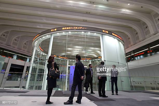 People visit the Tokyo Stock Exchange operated by Japan Exchange Group Inc in Tokyo Japan on Thursday Dec 17 2015 Japanese stocks followed US shares...