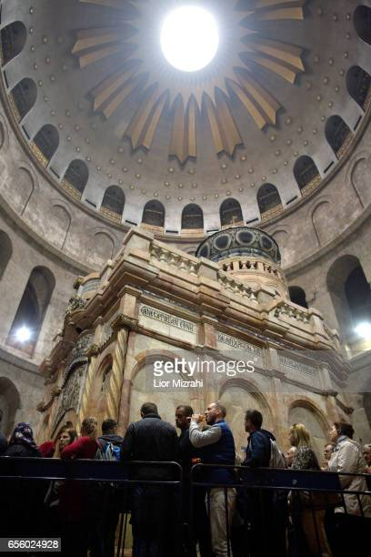 People visit The tomb of Jesus Christ with the rotunda is seen in the Church of the Holy Sepulchre on March 21 2017 in Jerusalem Israel The tomb of...